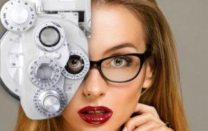 Woman with red lips having eye exam, wearing eyeglasses, in Huntington Beach