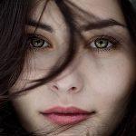 woman furry hat green eyes