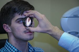 Patient taking an eye exam in Frisco, Breckenridge and Silverthorne, CO