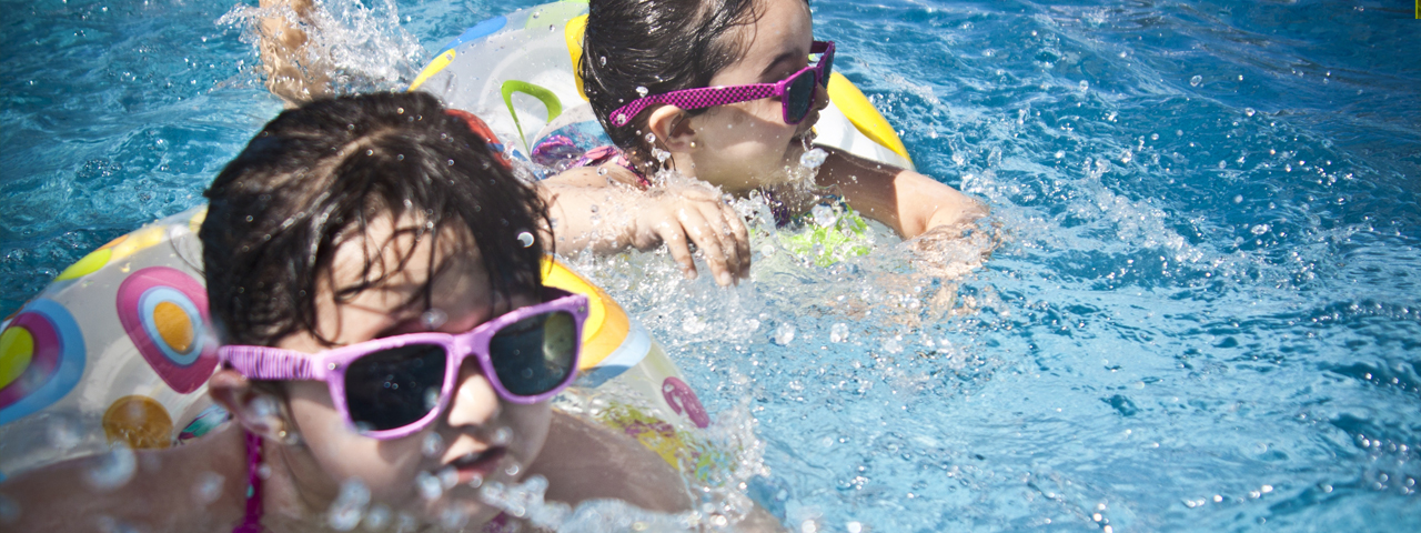 Children swimming, wearing sunglasses in St. Louis & St. Charles, MO