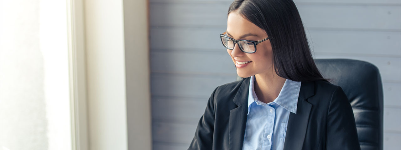 Eye care, woman smiling, wearing eyeglasses in St. Louis and St. Charles, MO