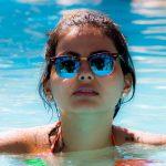 Woman in Pool Sunglasses 1280×853
