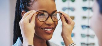 African Woman Trying on Glasses 1280x853 330x150