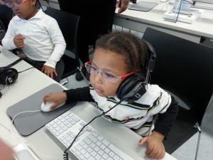 kids using computer in Kings Highway, Brooklyn, NY,