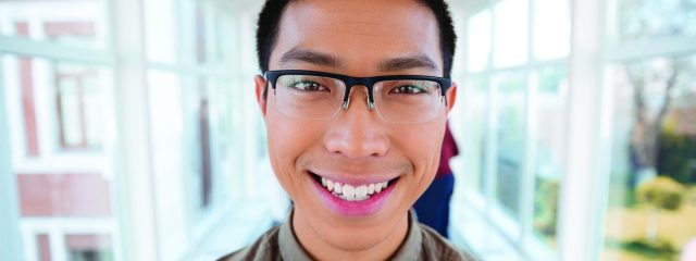 Eye doctor, asian teenager wearing astigmatism eyeglasses in Whitehall, PA