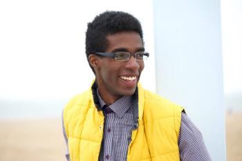 Man wearing eyeglasses and yellow vest in Wilmington
