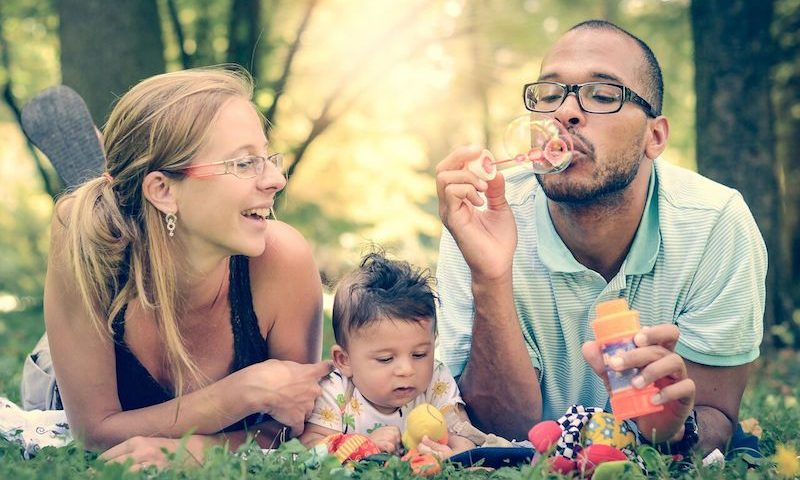 family wearing glasses and blowing bubbles800X533