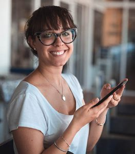 woman with mobile phone smile