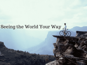 "man on bike on edge of cliff looking out, with words ""seeing the world your way"""