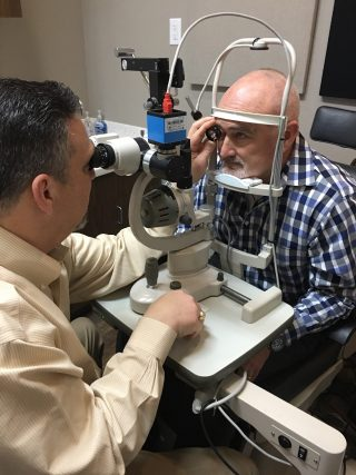 Dr. August Wallace eye exam with patient 1