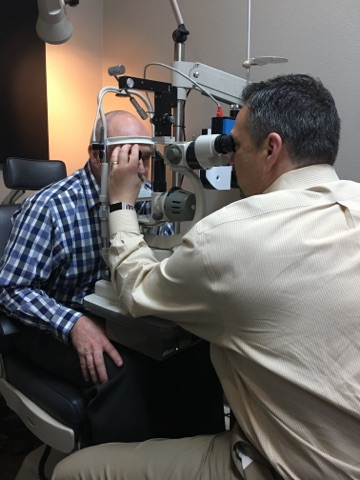 Dr August Wallace Eye Exam with patient in Longview, TX