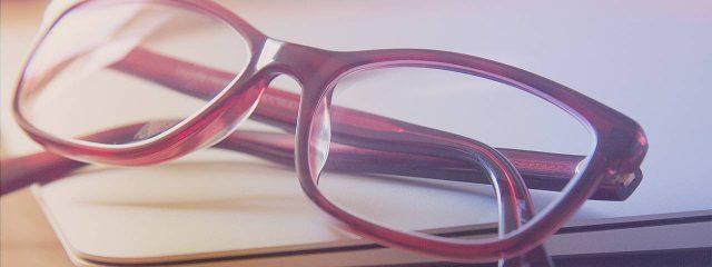 Optometrist, red glasses in Alpha, NJ