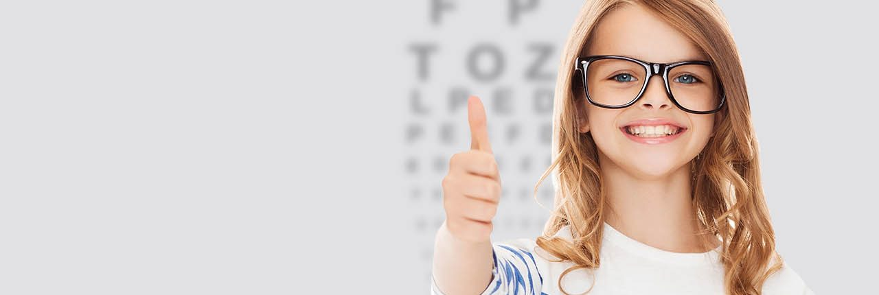 Eye doctor, girl giving the thumbs up in Milton, ON