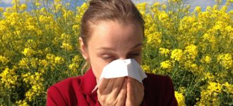 Woman Sneezing surrounded by flowers, Eye Doctor, Milton, ON