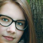 Woman, in woods, wearing eyeglasses