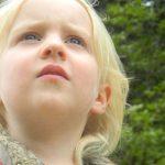 young girl with myopia