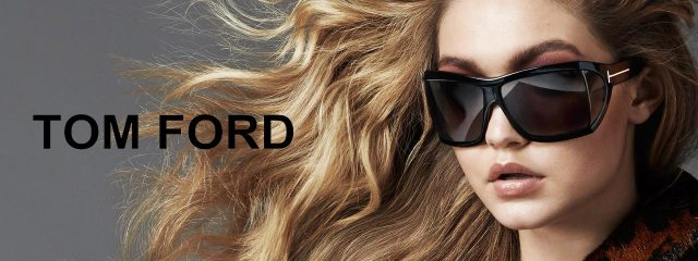 woman with long hair wearing tom ford designer frames at an eye exam in Seattle, WA