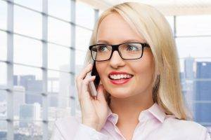 glasses on caucasian business woman using smartphone
