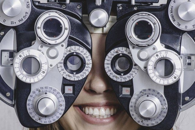 Woman smiling during an eye exam