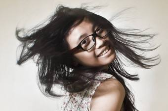 girl wearing eyeglasses and flipping hair