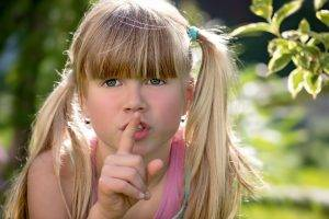 Young-Blond-Girl-Finger-on-Mouth