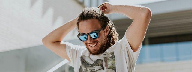 Optometrist, smiling man wearing nonprescription sunglasses in Round Rock, TX