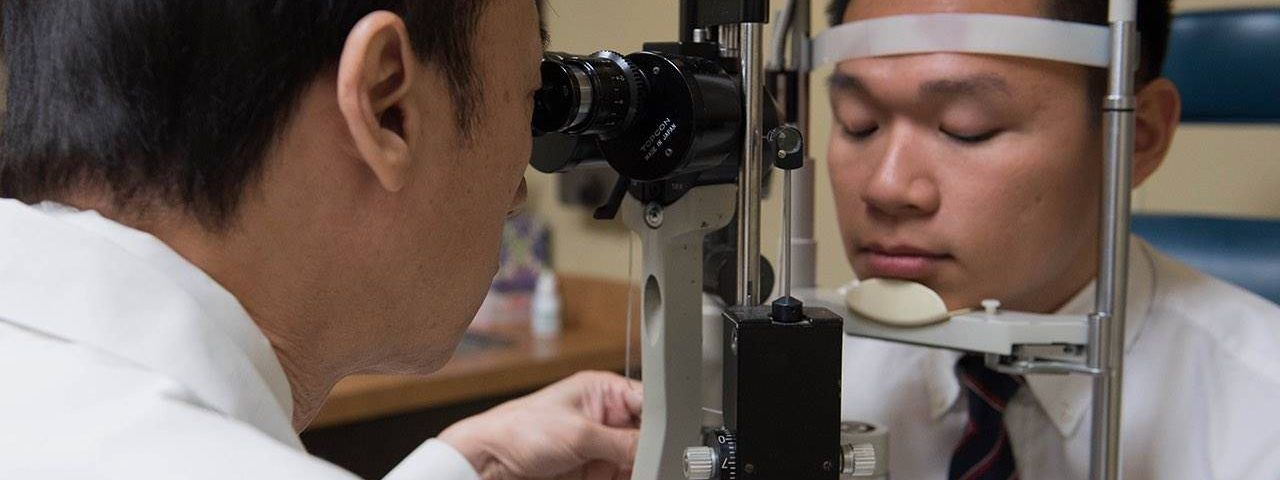 Eye exam, doctor examining patient in Round Rock, TX