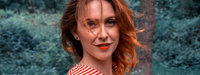 red_head_woman_striped_shirt 640x240