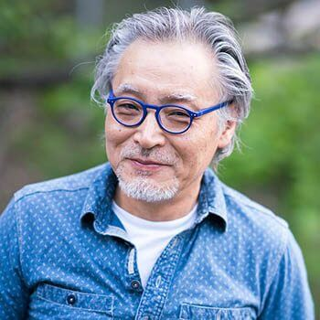 Man wearing blue eyeglasses in los alamitos, CA