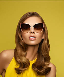 Model wearing Ray-Ban sunglasses