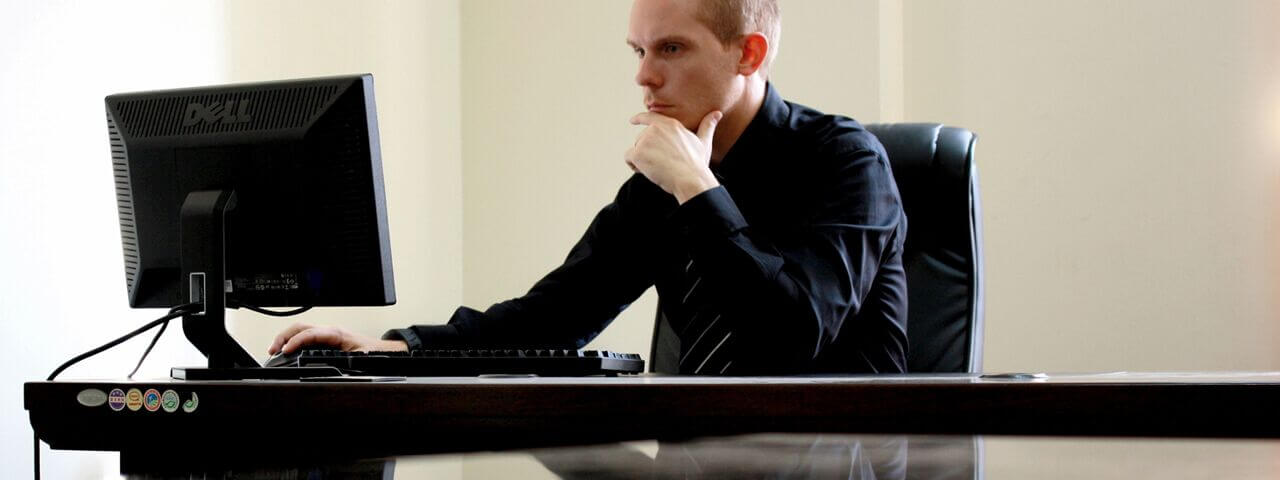 Man working in front of computer without glasses