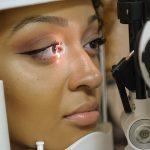 Woman taking an eye exam in Freelton, ON