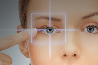 Eye exam, Woman Pointing to eye with lasik surgery in Freelton, ON
