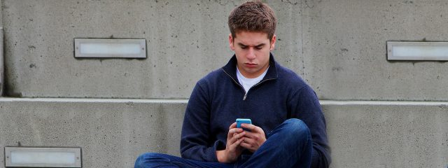 Male Teen Texting 1280x480 640x240