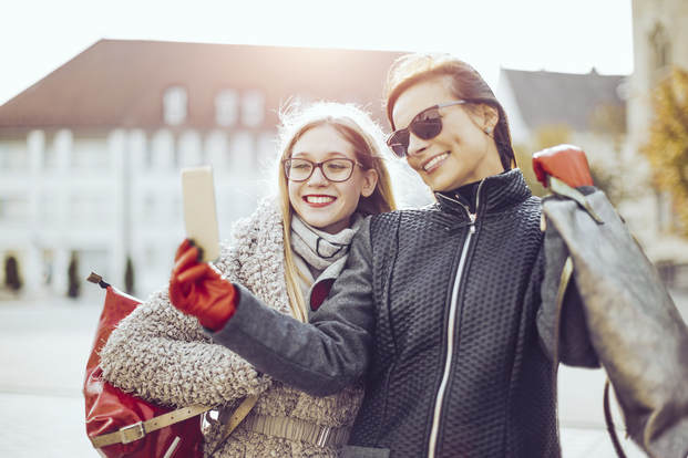 youngwomenshoppingsefie istock 615098756 2