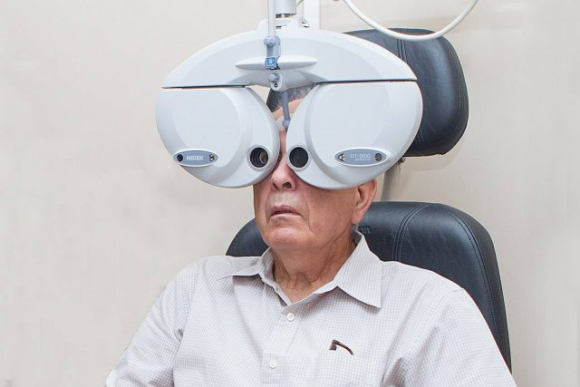 Eye doctor, senior man using a phoropter in Rocklin, CA