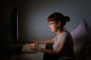 technology computer woman blue light 1280×853