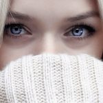 woman with blue eyes, behind sweater