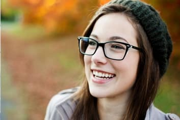 girl with glasses laughing