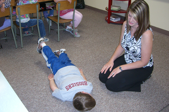 children follow up vision therapy with eye doctor clinton in