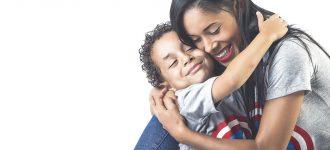 parent hugging son after eye emergency care