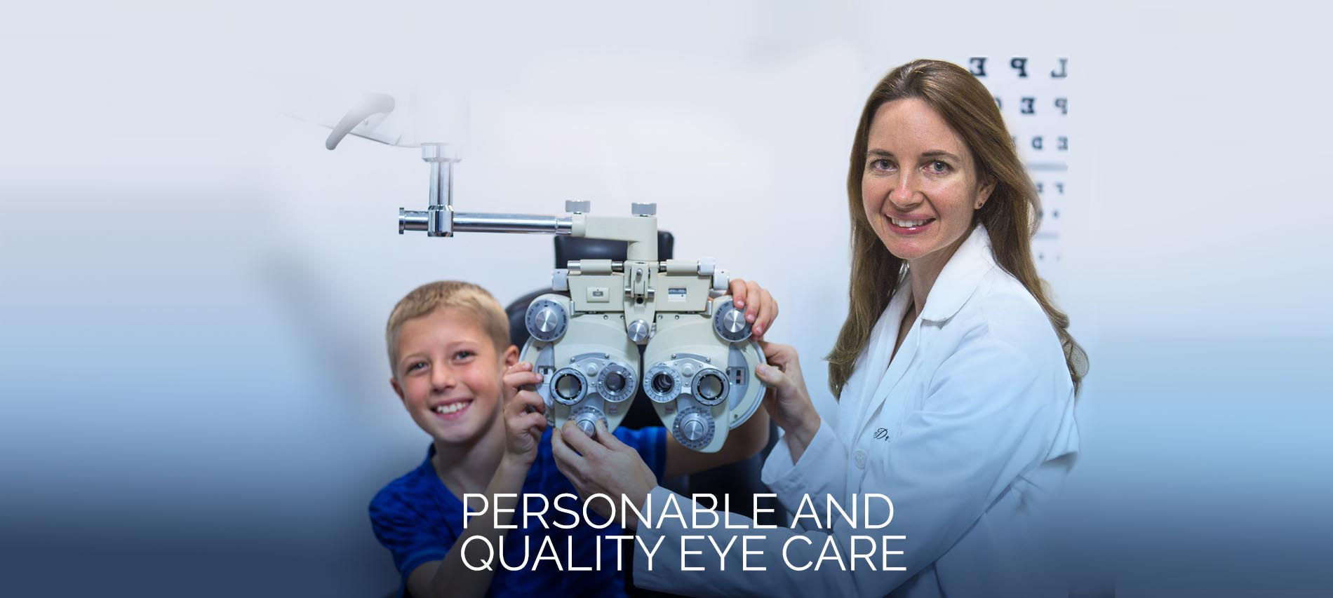 Dr. Ely and young boy in eye exam