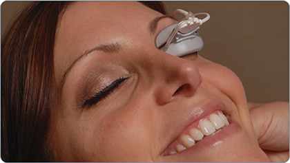Woman receiving lipiflow treatment for dry eyes in clarksville, TN