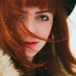 red-haired woman, with green eyes, in snow