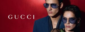Man and woman wearing sunglasses, Gucci