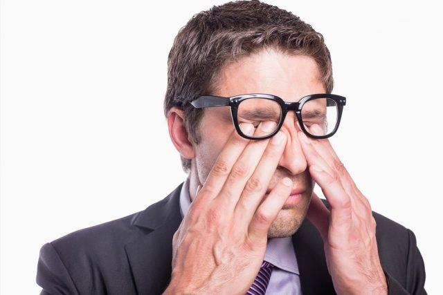 Eye doctor, man rubbing his eyes in GIlbert, AZ