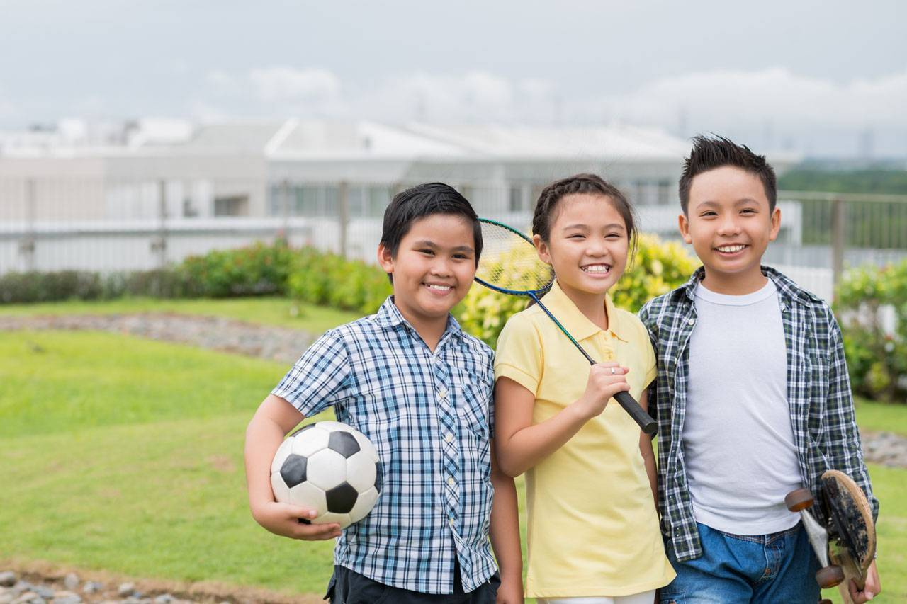 Asian kids playing various sports outside