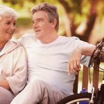 Eye care, couple sitting on bench in Garden Grove, CA
