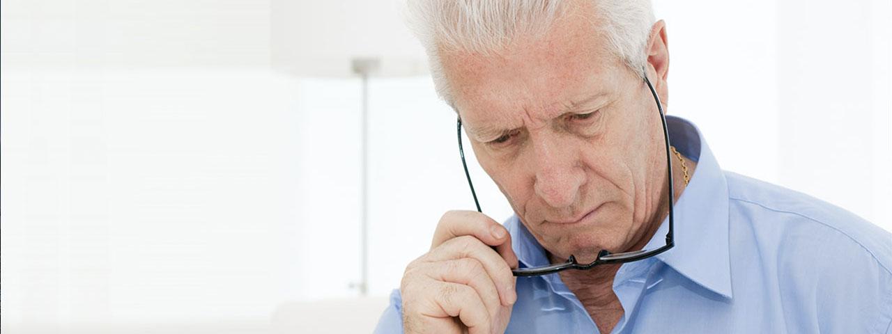 Eye care, elderly man putting on  eyeglasses in Garden Grove, CA