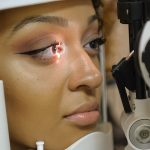 Optometrist, woman getting eyes checked in Garden Grove, CA